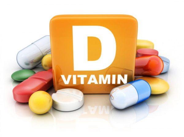 витамин D и капсулы вокруг него