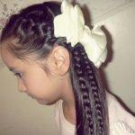 Девочка с косами с белым бантом